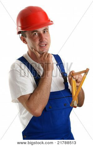 Craftsmen With Safety Helmet Holding A Ruler