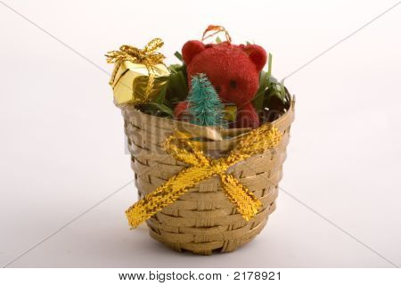 Christmas Basket Decorated With Toys, Gifts And Golden Bow