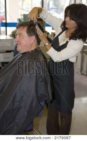 Woman Giving A Man A Haircut