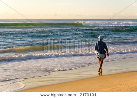 Beach Fisherman By Ocean As Sun Rises