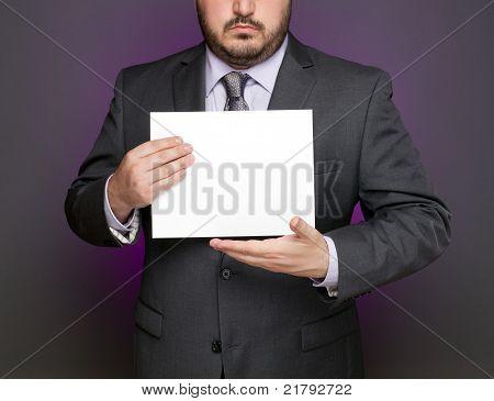 Businessman Holding Blank Sign