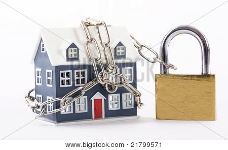 House secured with chain and padlock on white