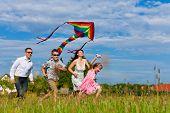 stock photo of kites  - Happy family  - JPG