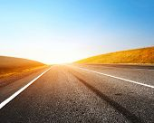 stock photo of race track  - Empty countryside asphalt road and clear blue sky - JPG