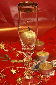 stock photo of x-max  - Golden apple in champagne glass on the red table cloth - JPG