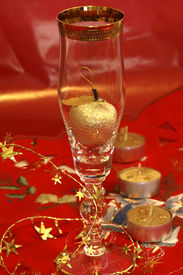 image of x-max  - Golden apple in champagne glass on the red table cloth - JPG