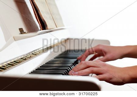 Playing Piano (shallow DOF; color toned image)