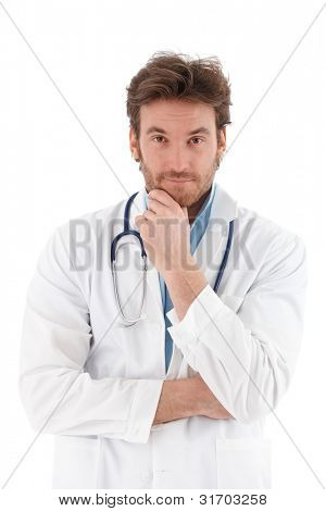 Handsome young doctor looking questioningly at camera.