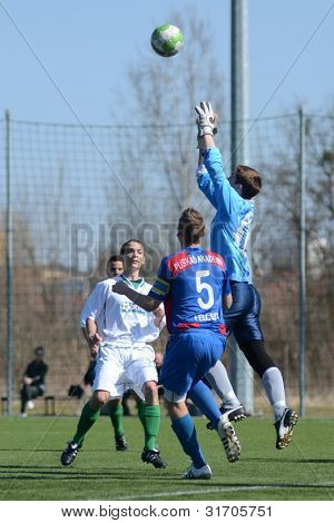KAPOSVAR, HUNGARY - MARCH 17: Edvard Rusak (goalkeeper) in action at the Hungarian National Championship under 18 game between Kaposvar(white)  and Videoton (blue) March 17, 2012 in Kaposvar, Hungary.