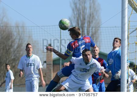 KAPOSVAR, HUNGARY - MARCH 17: David Kiprich (blue 5) in action at the Hungarian National Championship under 18 game between Kaposvar(white)  and Videoton (blue) March 17, 2012 in Kaposvar, Hungary.