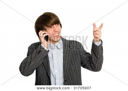 Stockbroker man talking on a cell, and points his finger to the side.