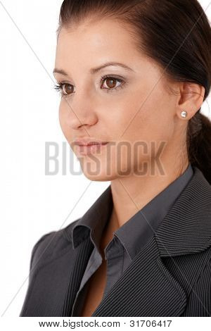 Portrait of pretty young businesswoman, half side view.