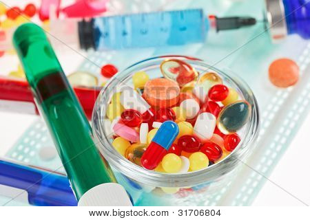 Pills, sterile mask, ampoules and syringe closeup still life,  medical concept