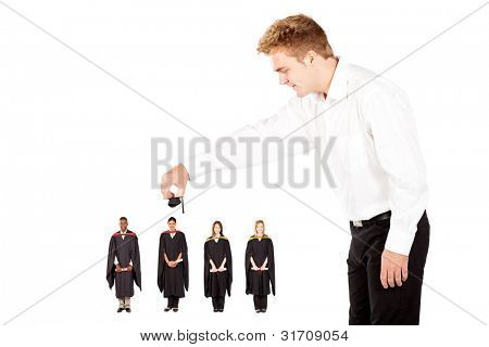 man putting cap on university graduate