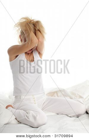 Distraught young woman on bed