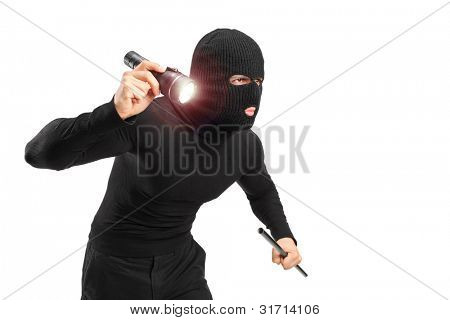 A robber with robbery mask holding a flashlight and piece of pipe isolated on white background