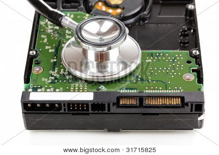 Stethoscope on hard disk drive isolated on white