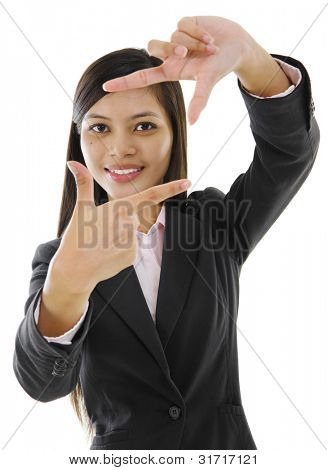 Mixed race Asian woman showing perspective hand sign