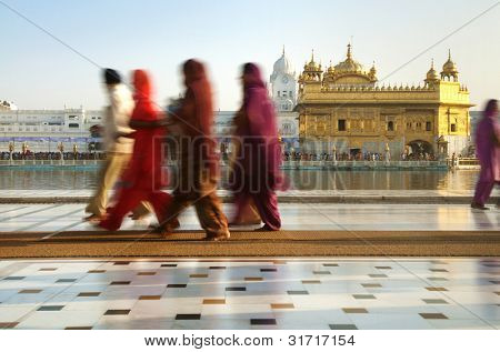 Group of Sikh pilgrims walking by the holy pool,Golden Temple,Amritsar,Punjab state,India,Asia
