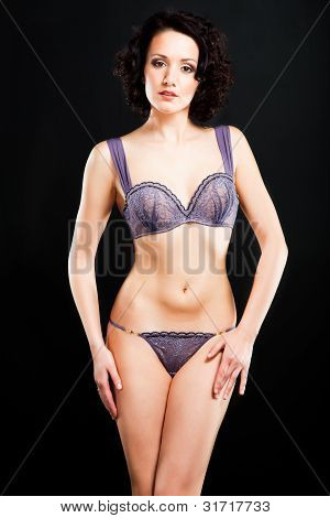 Girl In Lacy Underwear On Black Background