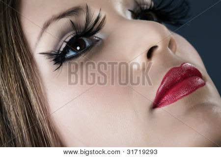 Close-up portrait of young model with red lips make-up