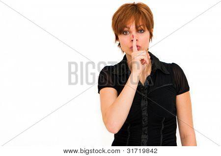 Portrait of a beautiful young fresh woman hushing