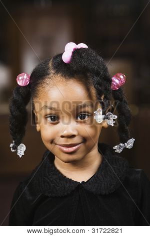 Portrait of African American girl with ponytails