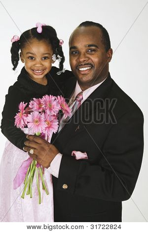 African American father and daughter wearing Sunday clothes