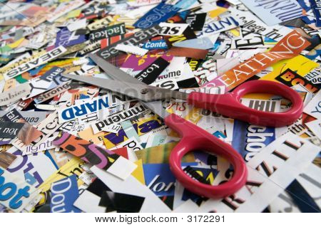 Scissors On Magazine Clipping Background