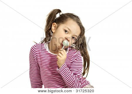 Close-up of adorable little girl with a lollipop, isolated on white background