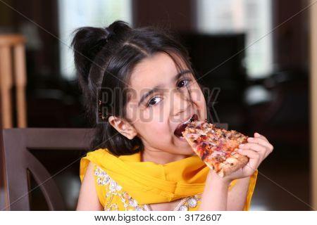 Girl Enjoys Pizza Slice