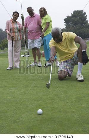 Senior man devising golfing strategy