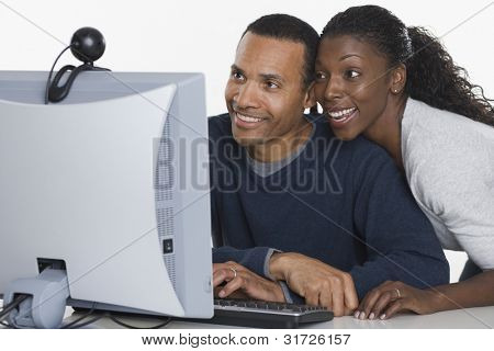 Couple looking at computer monitor together