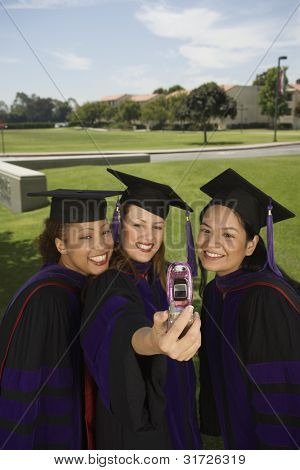 Female graduates taking self portrait