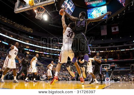 LOS ANGELES - MARCH 12: Arizona Wildcats F Jesse Perry #33 (L) & Washington Huskies F Darnell Gant #44 (R) during the NCAA Pac-10 Tournament championship gameon March 12 2011 at Staples Center.