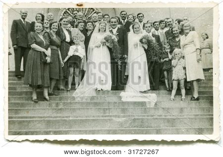 Vintage photo of two couples of newlyweds (forties)