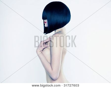 Elegant nude woman with short stylish hairstyle