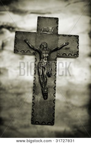 vintage background with the figure of Jesus Christ in the holy cross