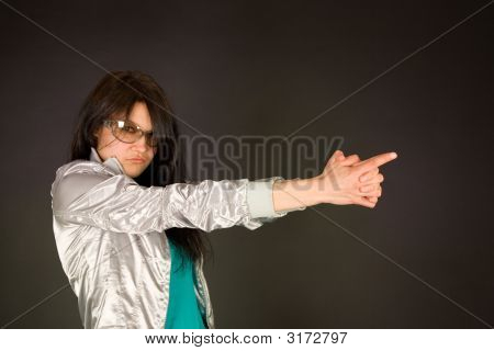 Fashion Girl Pointing Her Hand Like A Gun, Focus On Hands