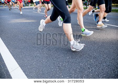 People running fast in a city marathon on a street