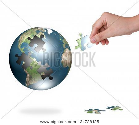 Business concept with a hand building puzzle globe (Elements of this image furnished by NASA)