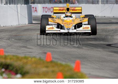 LONG BEACH - APRIL 17: Ryan Hunter-Reay driver of the #28 Andretti Autosport Team DHL / Sun Drop Citrus Dallara Honda races during the IndyCar Series Toyota Grand Prix on April 17 2011 in Long Beach.