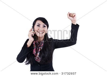 Elated Businesswoman Using Cell Phone