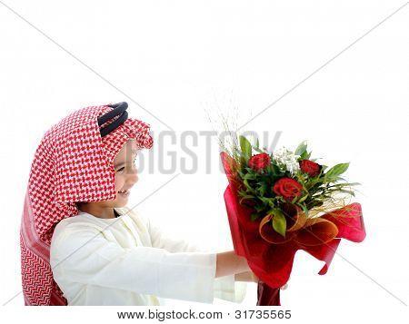 Arabian cute child holding flowers