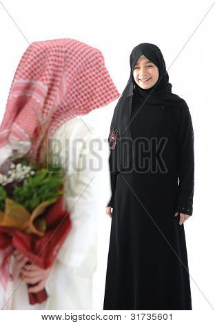 Arabian couple, roses and flowers as surprise