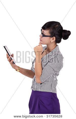 Thoughtful Woman With Digital Tablet