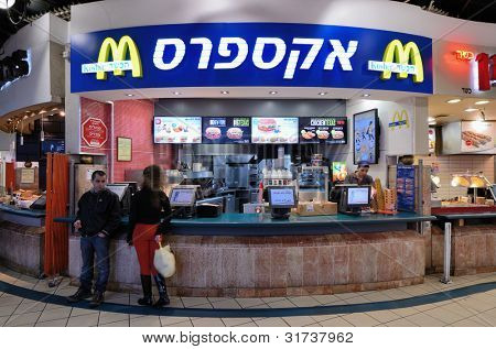 "JERUSALEM - FEBRUARY 19: Mcdonald's February 19, 2012 in Jerusalem, IL.The trademark yellow and red signs are replaced at some Israeli branches with blue and white signs with the Hebrew word ""kosher."""