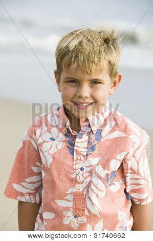 Portrait of boy on beach, smiling