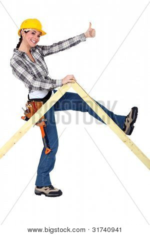 Peppy woman holding up a wooden frame