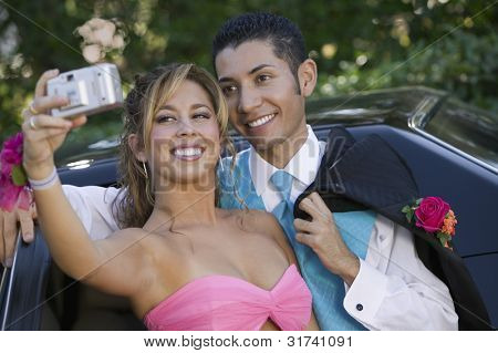 Teenage Girl Snapping Photo at Prom